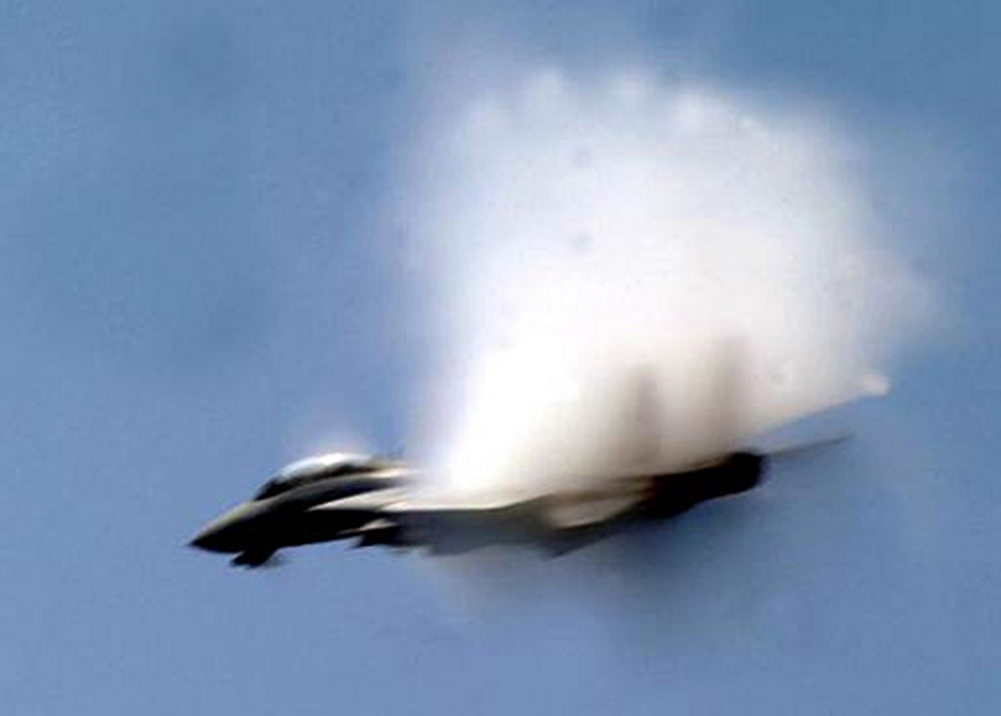6. A Fighter Jet From the Carrier Air Wing 8, 'Black Lions' VFA-213, United States Navy, Mediterranean Sea. Reaching the sound barrier, breaking the sound barrier: Flying at transonic speeds (flying transonically) -- speeds varying near and at the speed of sound (supersonic) -- can generate impressive condensation clouds caused by the Prandtl-Glauert Singularity. For a scientific explanation, see Professor M. S. Cramer's Gallery of Fluid Mechanics, Prandtl-Glauert Singularity at <http://www.GalleryOfFluidMechanics.com/conden/pg_sing.htm>; and Foundations of Fluid Mechanics, Navier-Stokes Equations Potential Flows: Prandtl-Glauert Similarity Laws at <http://www.Navier-Stokes.net/nspfsim.htm>. Photo Credit: Photographer's Mate Airman Michael McCannCole, Defend America News Photo (http://www.DefendAmerica.mil, May 2003, Breaking the Barrier, npi051203a1), United States Department of Defense (DoD, http://www.DefenseLink.mil or http://www.dod.gov), Government of the United States of America (USA).